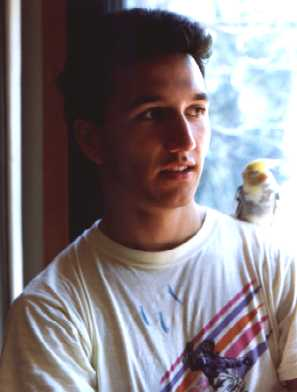 1990 (20 years old) My mom took this picture in my house. We just got Condorito, the bird on my shoulder.