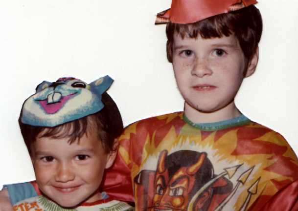 October 1974. My brother and I are all ready to get all those candies for Halloween. I'm looking as mischievous as ever.