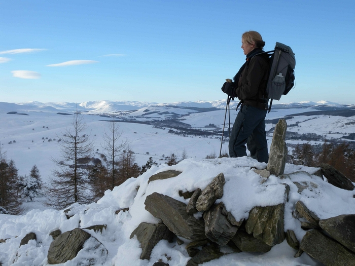Learning winter trekking skills in the hills of Scotland