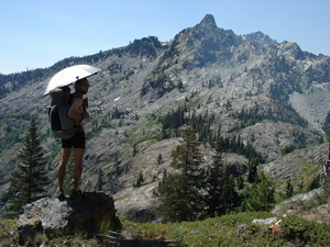 Overlooking the Trinity Alps with an umbrella on California's PCT