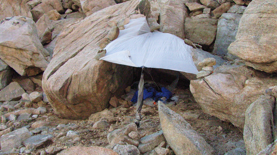 On the crest of the Wind River Range there are no trees, so I used my umbrella as an anchor for my tarp. In this camping spot I was stuck between a rock and hard place. :)