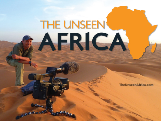Francis Tapon on a Sahara dune with his trusty Canon XF 300.