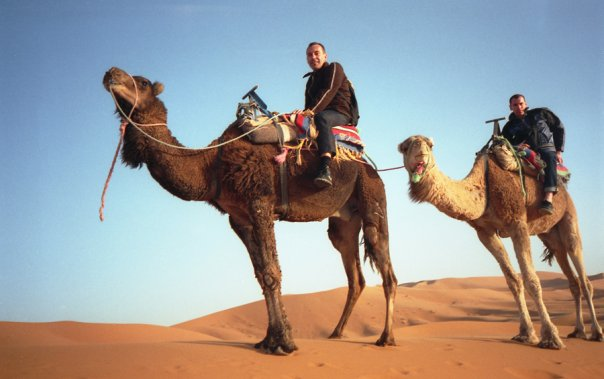 Clinton J. Wilson and his buddy on camels