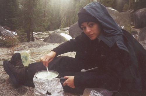 Lisa Garrett cooking while camping