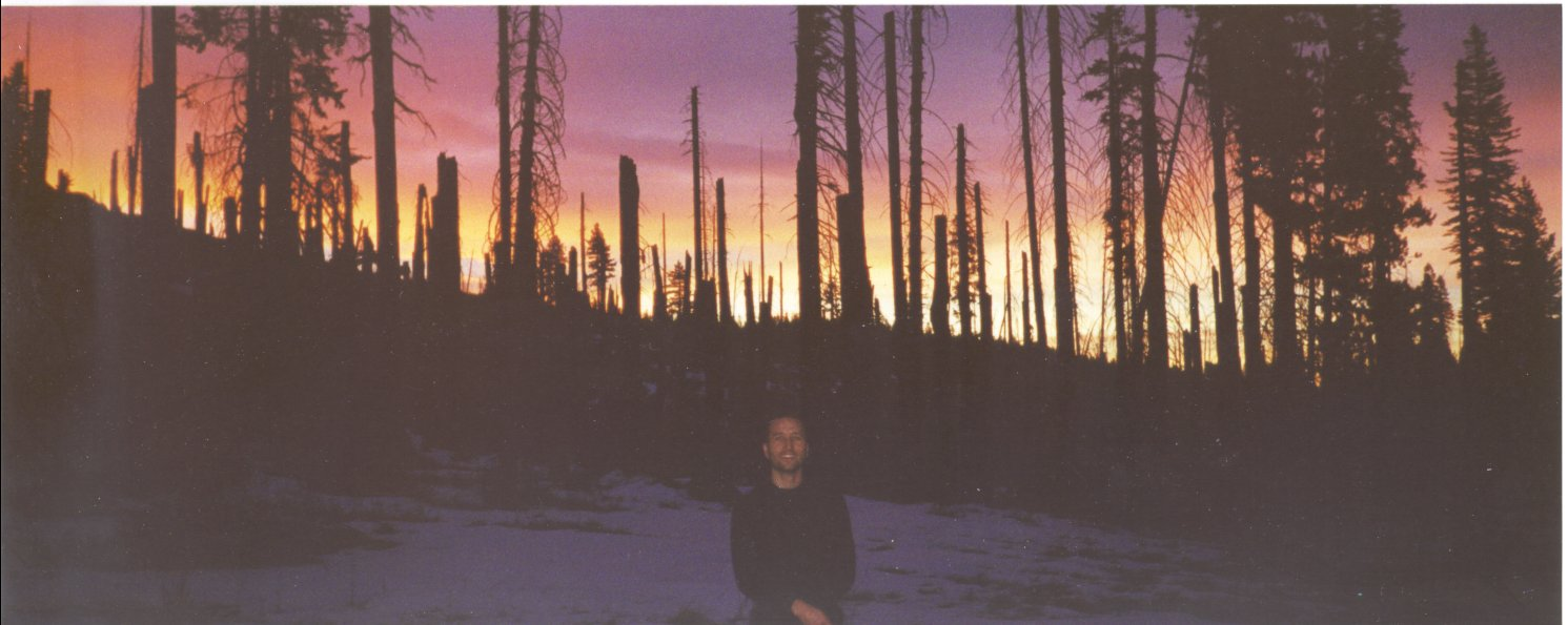 Francis Tapon posing in front of an amazing sunrise in a burned out forest Yosemite over Thanksgiving 2000.