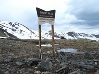 The passes are exposed to wind and sun, so they're often the first places to lose their snow in the spring.