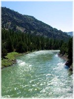 I didn't take this photo of the Yellowstone River, but it gives you an idea of what it was like to ford it in mid-June. The current was swift and the river was deep. For every forward stoke, I went downstream.