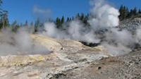 Mud holes, fumaroles, and geysers appear unexpectedly after several miles of dull trail in Yellowstone.