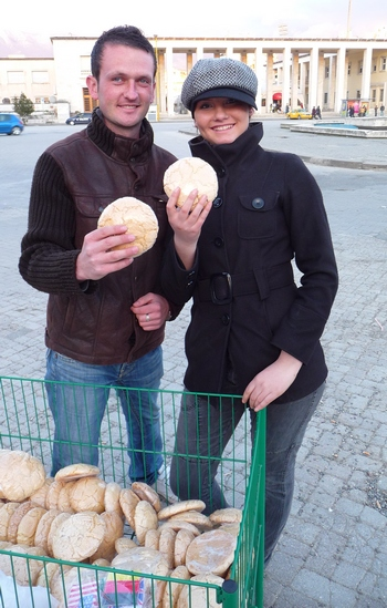 Albanian couple selling a sweet bread in Tirana, the capital of Albania