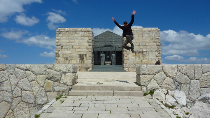 Francis Tapon jumping at Mt. Lovcen in Montenegro. It feels like heaven, but it's the Njegos Mausoleum