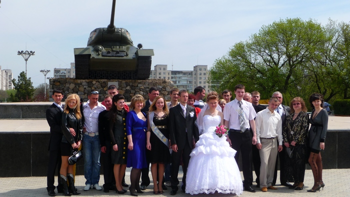 Wedding portrait with a tank in the background, very romantic setting in Tiraspol