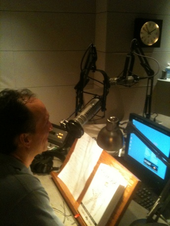 Francis sitting in KQED radio studios during Rick Steves interview