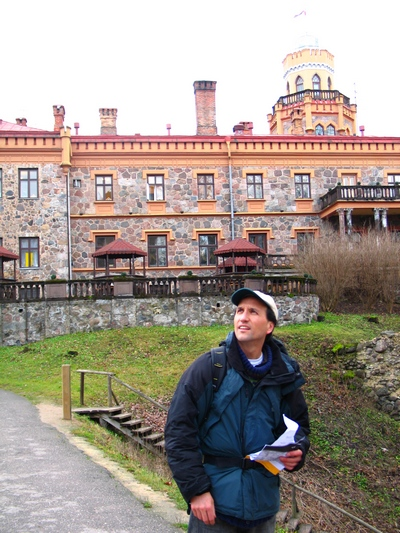 Francis Tapon being a tourist - observing everything in Latvia with a map in hand