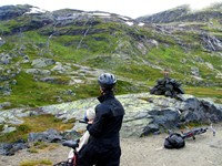 Maiu takes a break on the Rallarvegen to admire the cascades of fresh, glacier water