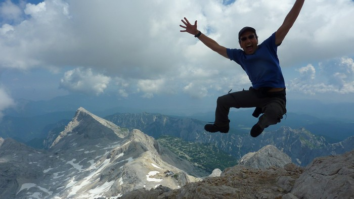 Francis Tapon jumping for joy on top of Mt. Triglav in Slovenia