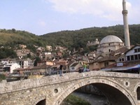 Beautiful old bridge in Prizren, Kosovo. A ruined Serb neighborhood is in the hills.