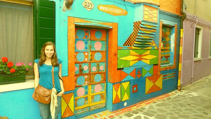 Ana next to a colourful house on Burano