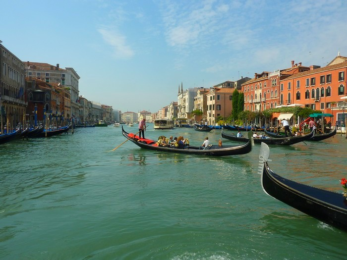 Gondolas driving the tourists through the Grand Canal