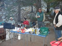 You'd think we were car camping, but we were in the middle of nowhere in Yosemite. They had tables, a full bottle of olive oil, coffee, a heavy white canister with propane (below the table), a mattress, 15 pairs of underwear, and enough fresh food to feed an army of thru-hikers. It took them three hours to load everything on their three horses and five mules.