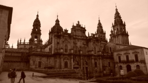 The Cathedral at Santiago de Compostela. Luis, a pilgrim who hiked El Camino twice, is holding his walking stick in the corner of the photo.